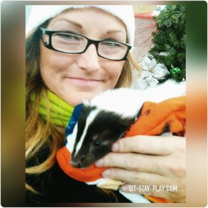baby skunk and Kelley Stewart